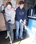 Volunteers help others to clean up after Sandy sweeps through