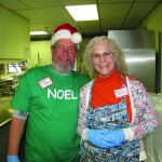 George Payne and Marsha Rosenstock help out in the kitchen during the NOEL Community's 14th annual Christmas Day dinner last year at St. Paul's by-the-Sea Episcopal Church hall, located on Third Street and Baltimore Avenue.