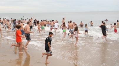 PENGUIN PARTY: More than 600 'penguins' participate in annual swim