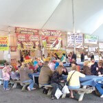Visitors to Springfest, held May 2-5, in the Ocean City inlet parking lot, enjoy some food on Sunday afternoon.