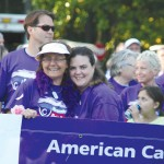 "Jean ""Bean"" Keagle, left, and Kathy McDaniel participate in the ceremonial first lap of the night, the Survivors' Lap, during the 2012 North Worcester County Relay For Life last year at Frontier Town Campground in West Ocean City, a fundraiser for the American Cancer Society."