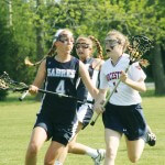 Worcester Prep junior Meg Lingo, right, carries the ball toward the Sts. Peter & Paul goal during last Friday's Eastern Shore Independent Athletic Conference championship game in Berlin. Lingo scored two goals in Worcester's 20-5 victory.