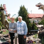 Judy and Herb Schoellkopf stand on the Old Pro Golf Dinosaur themed course on 68th Street last Friday. Old Pro Golf will celebrate 50 years in Ocean City on Saturday.