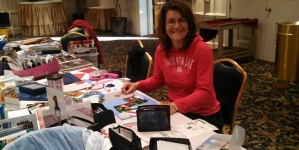 Put together scrapbooks during Crop Out Cancer Day