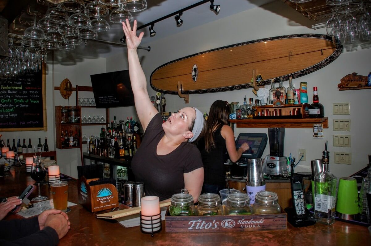 Morgan Fagan jumped behind the bar to help out as people started rolling in for Happy Hour.
