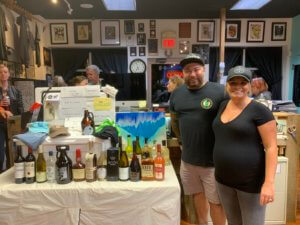 Justin & Brittney Acita of Pickles with Yeti cooler & prizes at Independent Tattoo